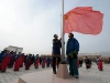 Students salute at the national flag-raising ceremony on the first day of new semester in the School for Nationalities in Tianzhu Tibet Autonomous County, northwest China's Gansu Province, Feb. 25, 2009. Tibetans across China are celebrating the 50th Tibetan New Year after the Democratic Reform with their old traditions.