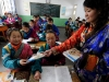 Students receive free textbooks on the first day of new semester in the School for Nationalities in Tianzhu Tibet Autonomous County, northwest China's Gansu Province, Feb. 25, 2009. Tibetans across China are celebrating the 50th Tibetan New Year after the Democratic Reform with their old traditions.